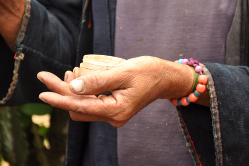Hand-with-beads
